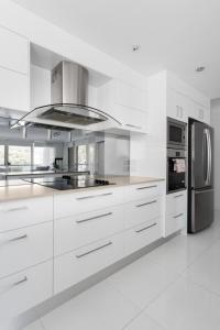 A kitchen or kitchenette at Stunning Burleigh Beach Apartment