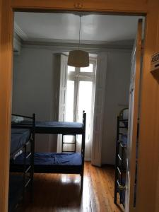 A bunk bed or bunk beds in a room at Albergue De Peregrinos La Bilbaina