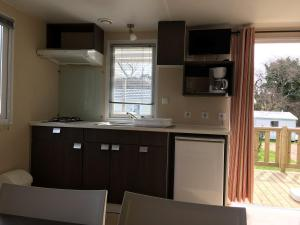 A kitchen or kitchenette at West Camping