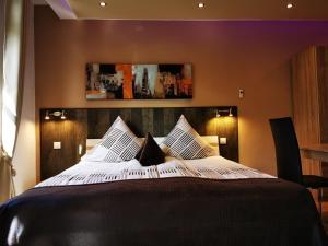 Ein Bett oder Betten in einem Zimmer der Unterkunft Apartmenthaus Wertheim