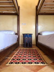 A bed or beds in a room at Equity Point Marrakech