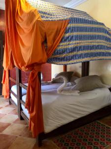 A bunk bed or bunk beds in a room at Equity Point Marrakech