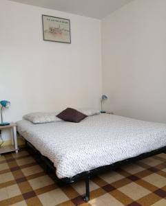 A bed or beds in a room at Meublé de tourisme Bel être