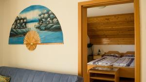 A bed or beds in a room at Guest House Alenka