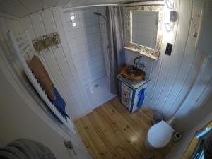 Ein Badezimmer in der Unterkunft Alexanderhaus