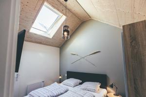 A bed or beds in a room at Zoetenaar Zoutelande
