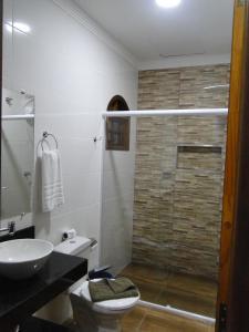 Um banheiro em Pousada Morada Do Sol
