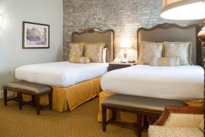 A bed or beds in a room at French Market Inn