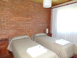 A bed or beds in a room at Cabañas de Nené Aparts