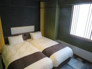 A bed or beds in a room at Kashoutei Hanaya