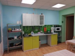 A kitchen or kitchenette at Хостел Радуга