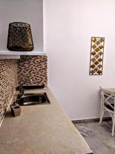 A kitchen or kitchenette at Idomeneas Apartments