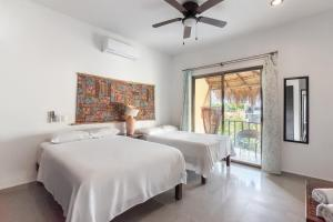 A bed or beds in a room at Capital O Villas Akalan