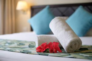 A bed or beds in a room at Fiji Gateway Hotel