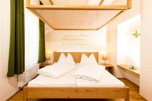 Ein Bett oder Betten in einem Zimmer der Unterkunft Himmlisch Urlauben Söchau