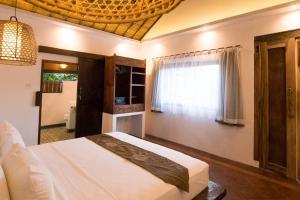 Ein Bett oder Betten in einem Zimmer der Unterkunft The Mandana Gili Air