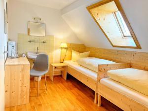 Ein Bett oder Betten in einem Zimmer der Unterkunft Gasthof Graf