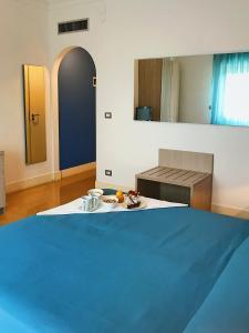 Кровать или кровати в номере Hotel Conchiglia d'Oro
