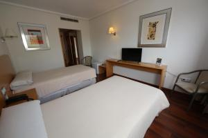 Кровать или кровати в номере Hotel Universidad