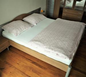 A bed or beds in a room at Apartmán Adam