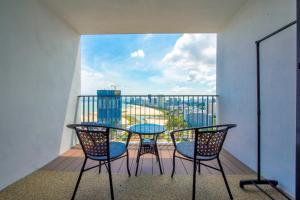 A balcony or terrace at The Landmark By Little Cabin
