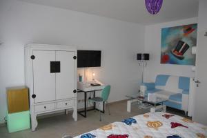 TV/Unterhaltungsangebot in der Unterkunft Gästezimmer am Elberadweg