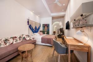 A seating area at Aisha Petite Suites