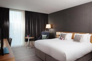 A bed or beds in a room at Crowne Plaza Newcastle - Stephenson Quarter
