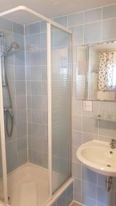 Ein Badezimmer in der Unterkunft Hotels Green Lemon Garni – Haus Krähenhütte