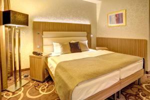 En eller flere senge i et værelse på NordWest-Hotel Bad Zwischenahn