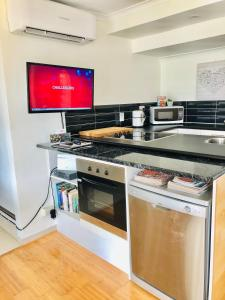 A kitchen or kitchenette at Bella by the beach