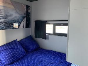 Łóżko lub łóżka w pokoju w obiekcie HAUSBOOT