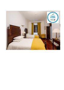 Uma cama ou camas num quarto em Casa Amarela TH & National Monument
