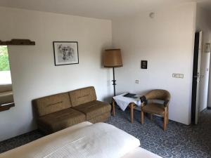 Ein Sitzbereich in der Unterkunft Hotel Gasthof Seefelder Hof