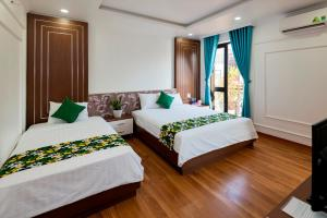 A bed or beds in a room at Mai Ha Boutique Hotel