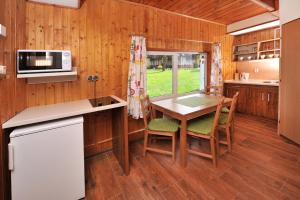 Kuchyňa alebo kuchynka v ubytovaní APLEND Chaty Tatry Holiday