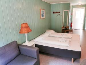 Кровать или кровати в номере Gudvangen Fjordtell & Apartments