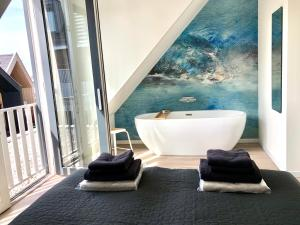 Een badkamer bij Plein 40 - Lodges