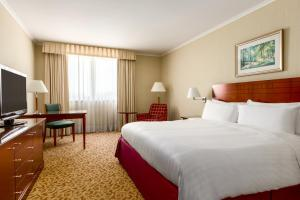 A bed or beds in a room at Paris Marriott Charles de Gaulle Airport Hotel