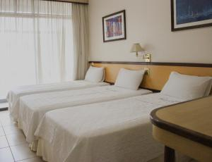 A bed or beds in a room at Hotel Casablanca