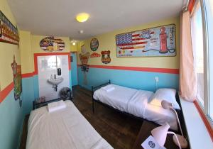 A bed or beds in a room at The Flying Pig Beach Hostel