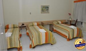 A bed or beds in a room at CHA Klein Ville Light
