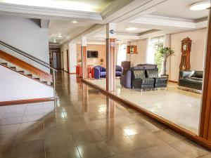 The lobby or reception area at Milão Hotel