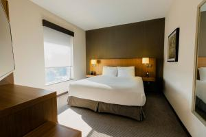 A bed or beds in a room at Hyatt Place Augusta