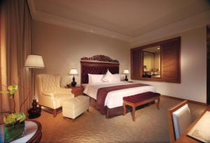 A bed or beds in a room at Royale Chulan Kuala Lumpur