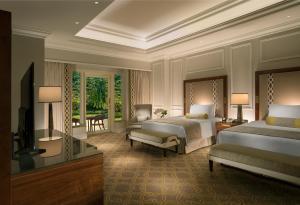 מיטה או מיטות בחדר ב-The Venetian Macao