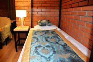 Кровать или кровати в номере Отель Варшавка Инн