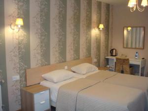 Кровать или кровати в номере Гостиница Tea Rose