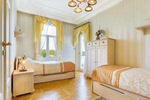 Postel nebo postele na pokoji v ubytování Apartmán Nostalgia