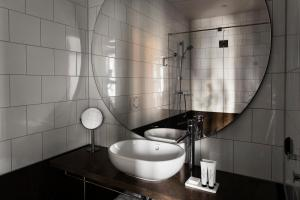 A bathroom at Miss Clara by Nobis, Stockholm, a Member of Design Hotels™